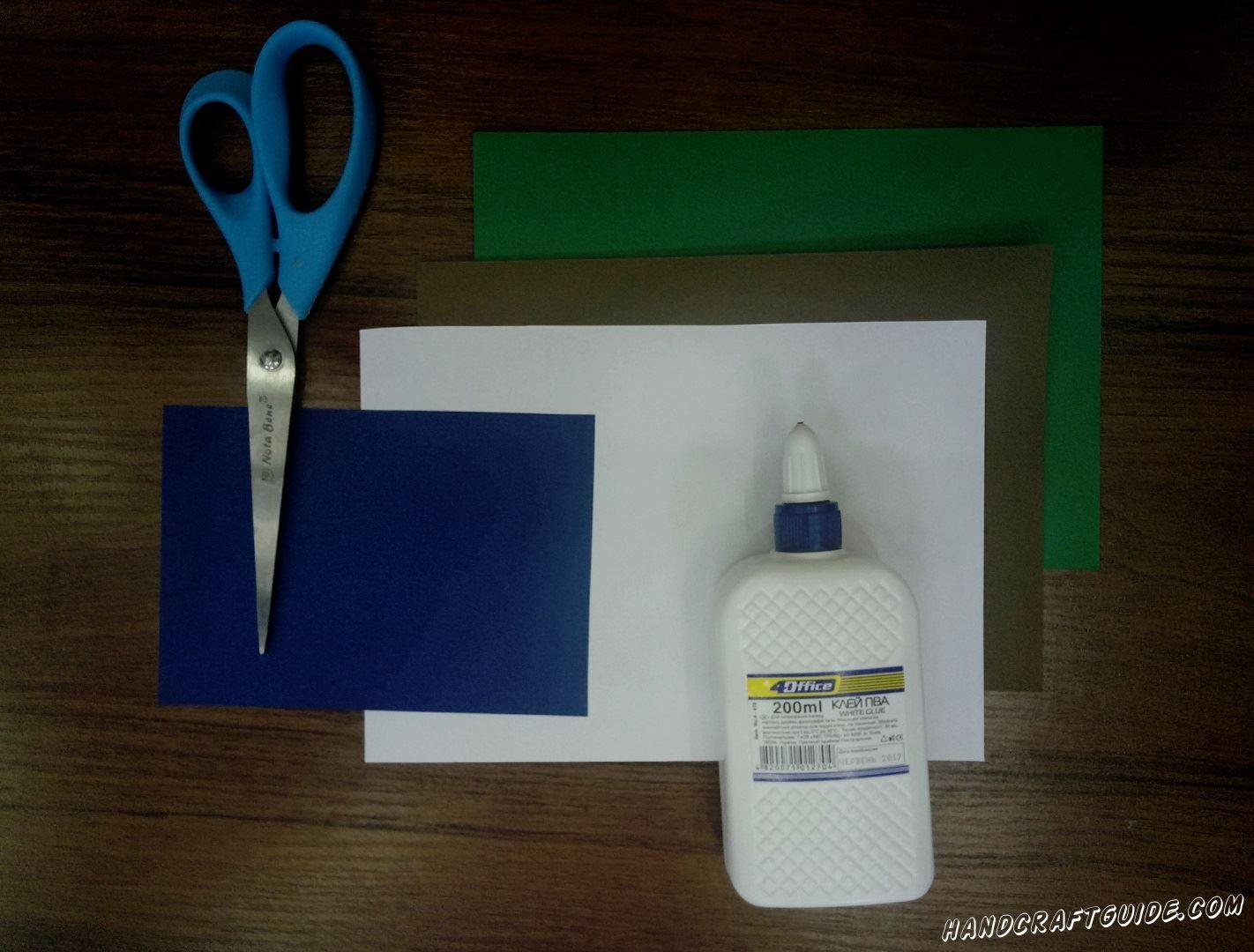 А понадобится нам:  Цветная бумага 4 листа : зелёный , синий , белый , коричневый Ножницы Клей ПВА