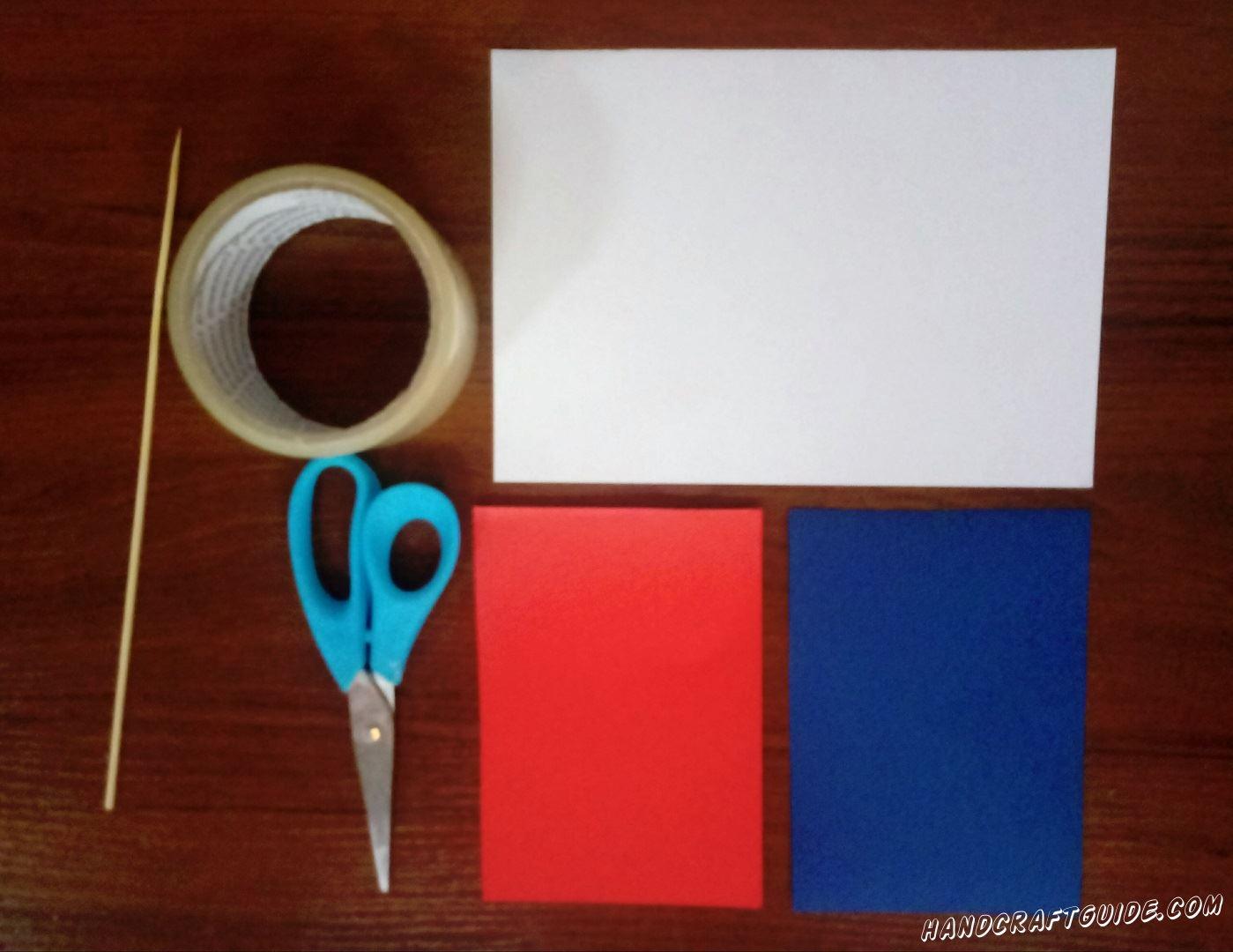 Берём синий лист бумаги А4 и отрезаем от него 1/3 часть по горизонтали. Чтоб узнать сколько это, можно использовать линейку:)  Потом такую же частичку вырезаем из красной. С этим будет полегче, ведь мы можем просто приложить нашу синюю часть и просто вырезать ровно такую же.