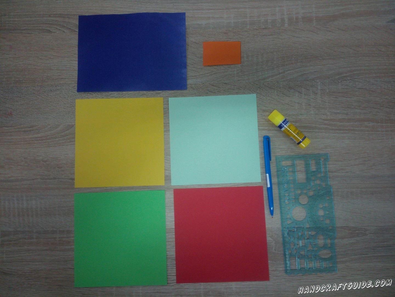 Для выполнения данной поделки нам понадобится: Цветная бумага Ножницы Клей Шарикова ручка Линейка