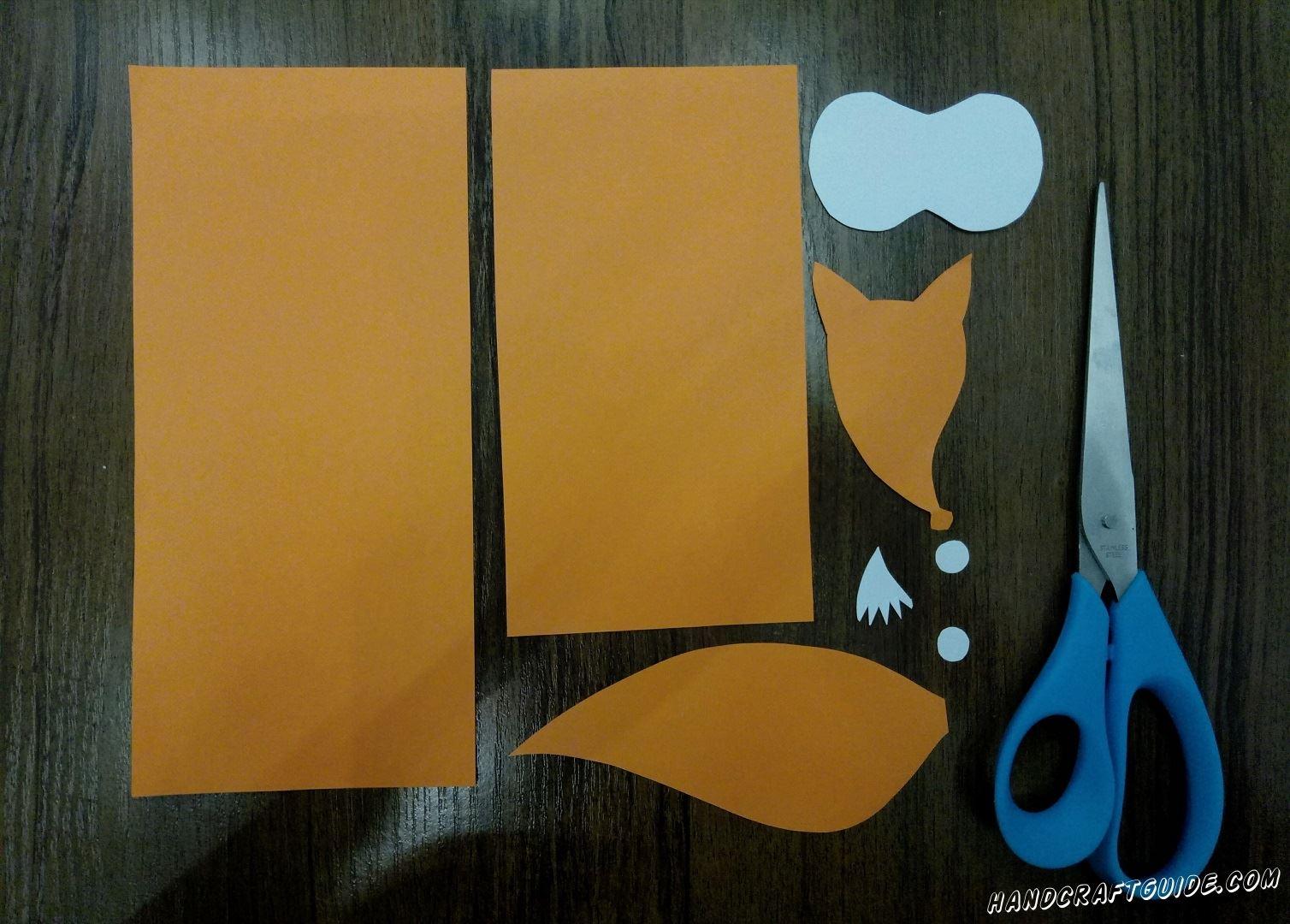 Из оранжевой и белой бумаги вырезаем все необходимые нам детали,как на фото
