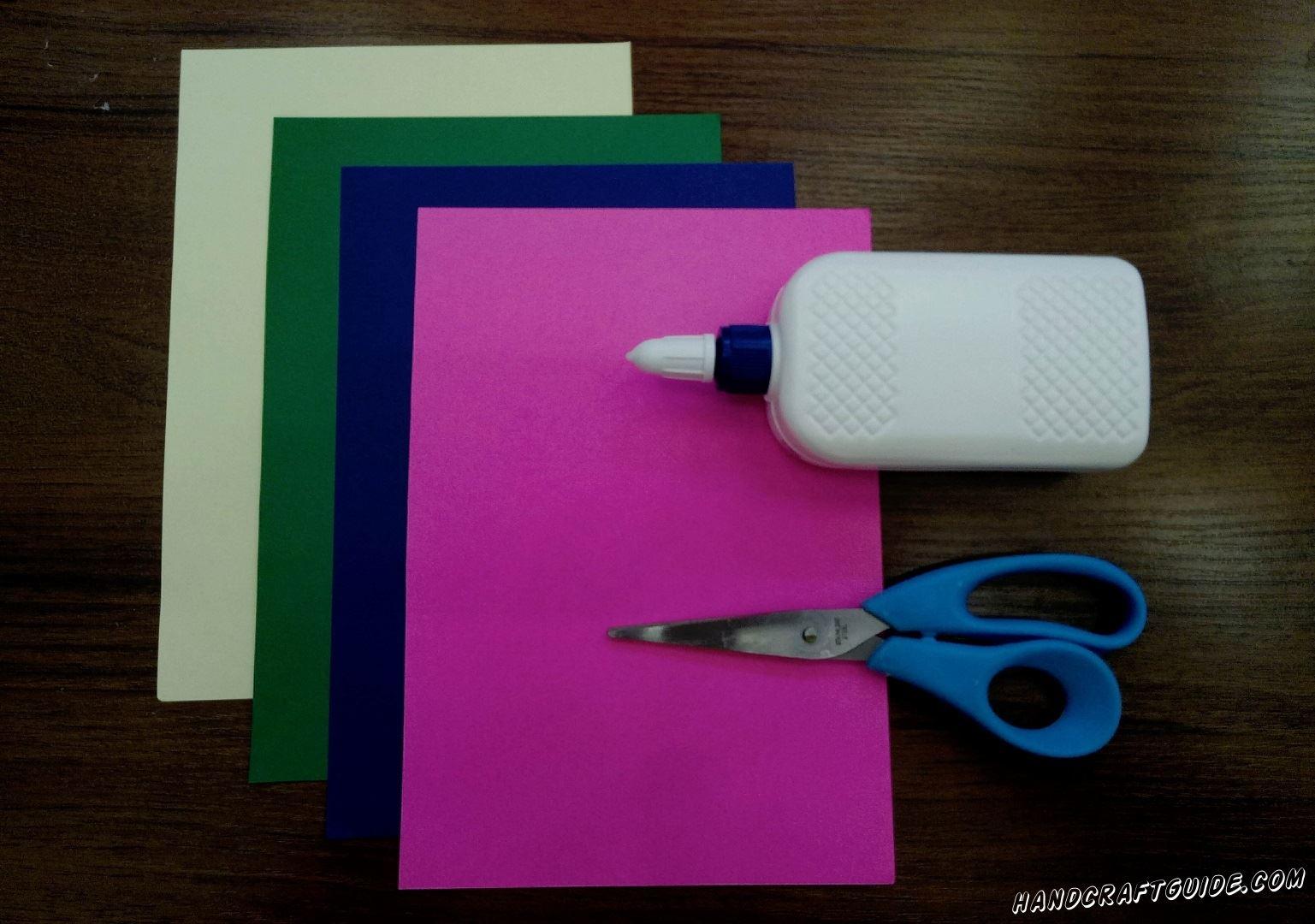 А для этого нам понадобится: Цветная бумага: желтый,зелёный,синий, розовый листы А4 Ножницы Клей ПВА