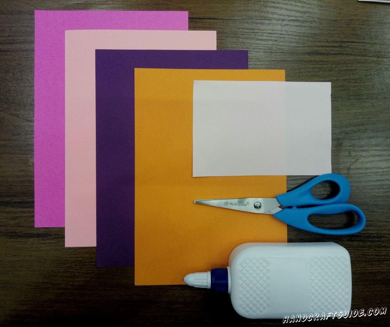 Для этого нам понадобится: Цветная бумага плотная : сиреневая, розовая, фиолетовая, оранжевая, белая Ножницы Клей
