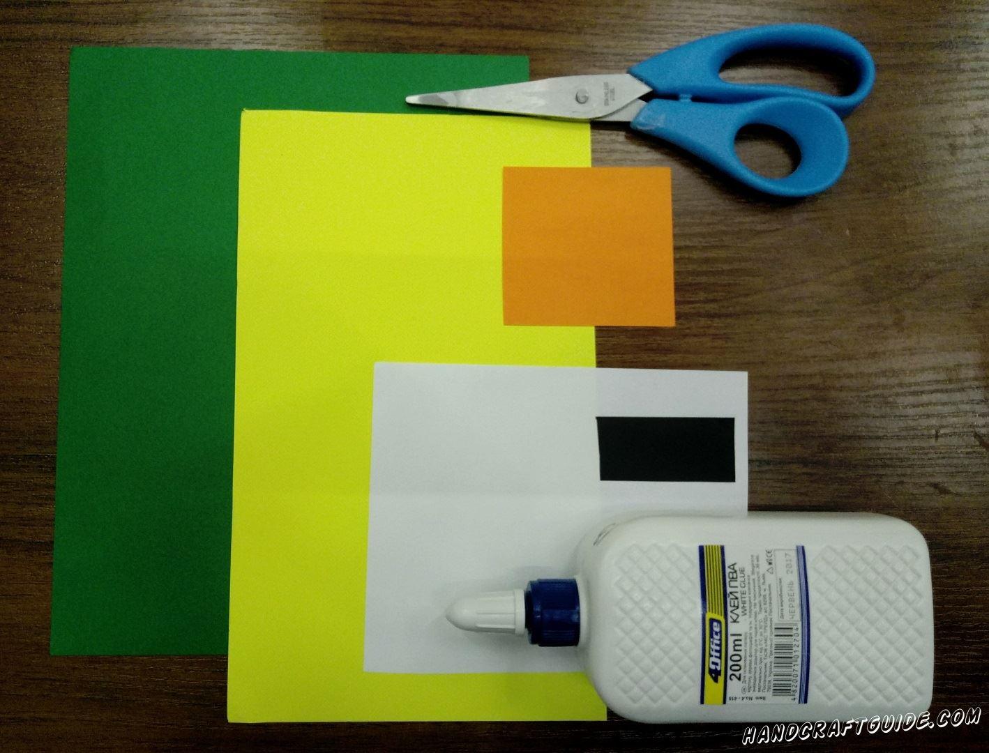 Для этого нам нужно: Листы цветной бумаги: зелёный,желтый, оранжевый, белый, чёрный Клей ПВА Ножницы