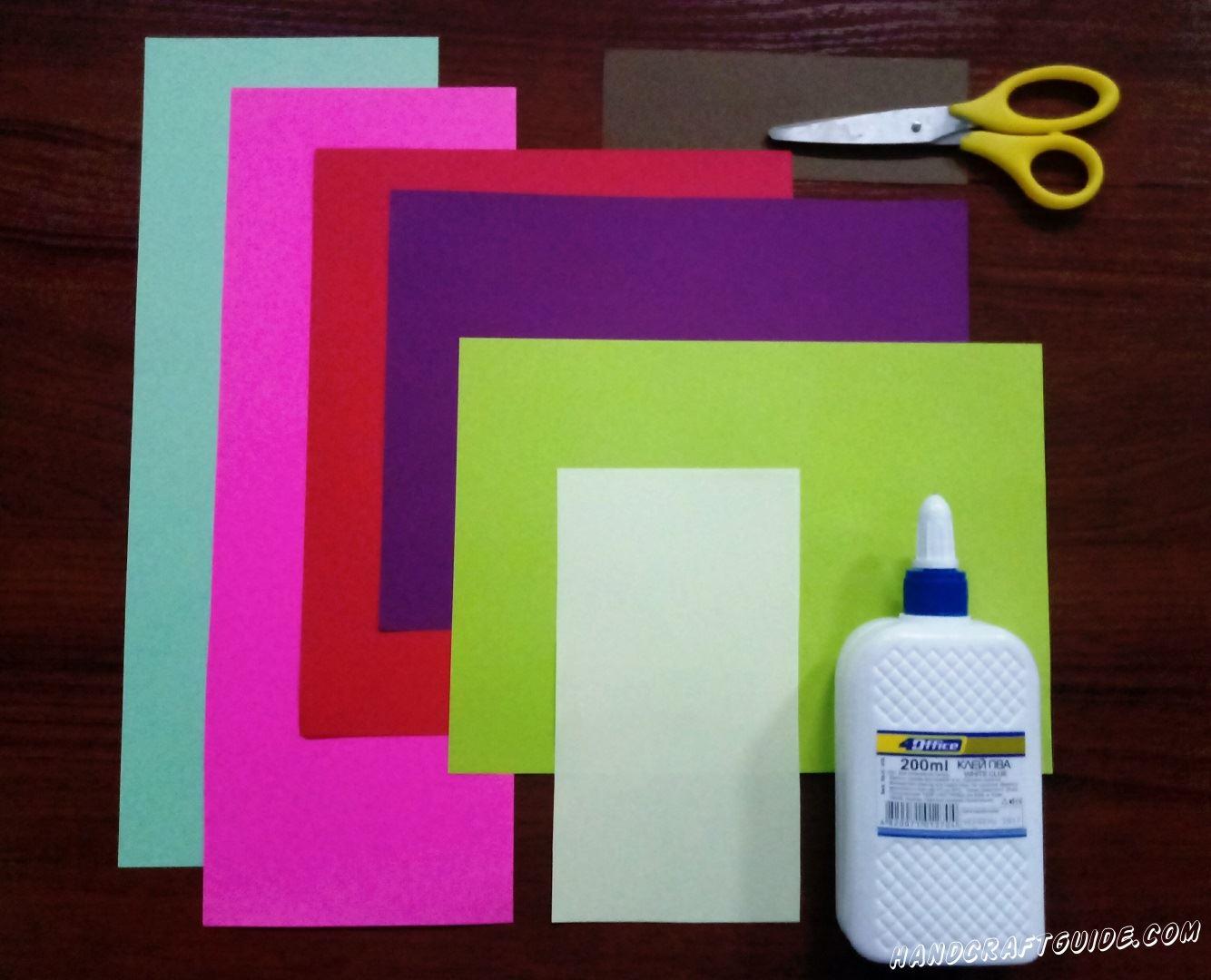 И для этого нам нужно: Цветная бумага Клей Ножницы