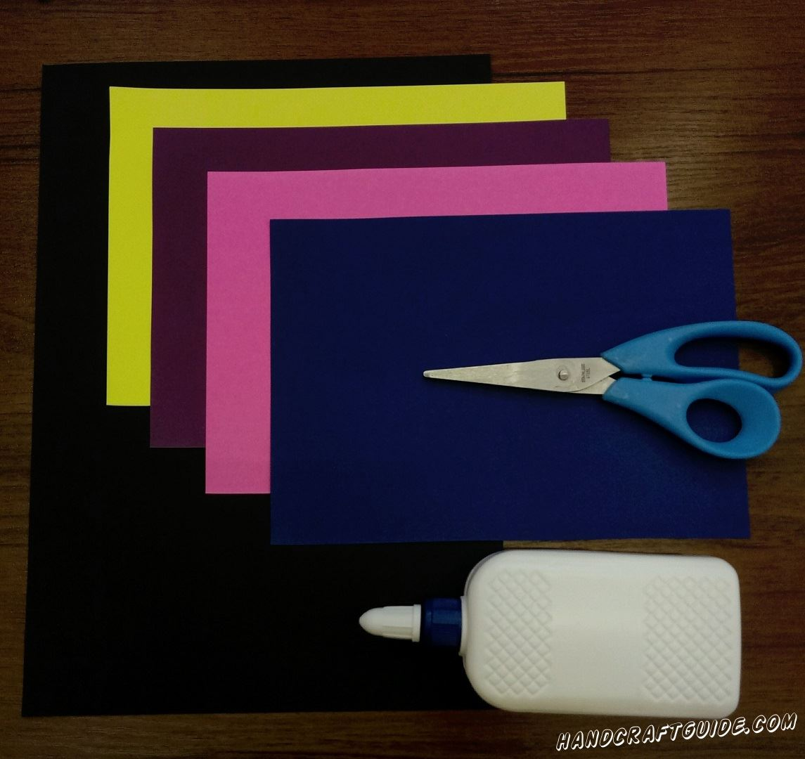 Для этого нам понадобится: Цветная бумага: чёрная, фиолетовая, синяя, розовая, желтая Ножницы Клей ПВА Фигурные ножницы