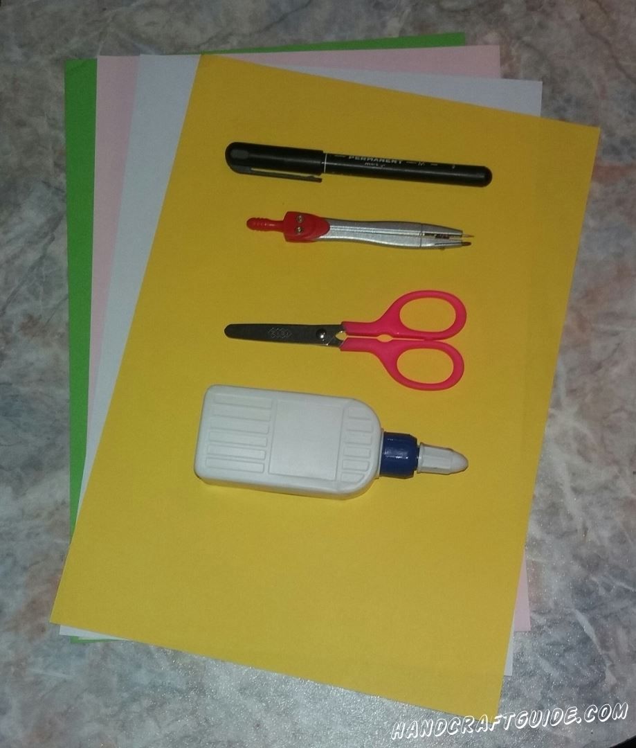 Для этого нам понадобится: Цветная бумага Клей ПВА Ножницы Фломастер