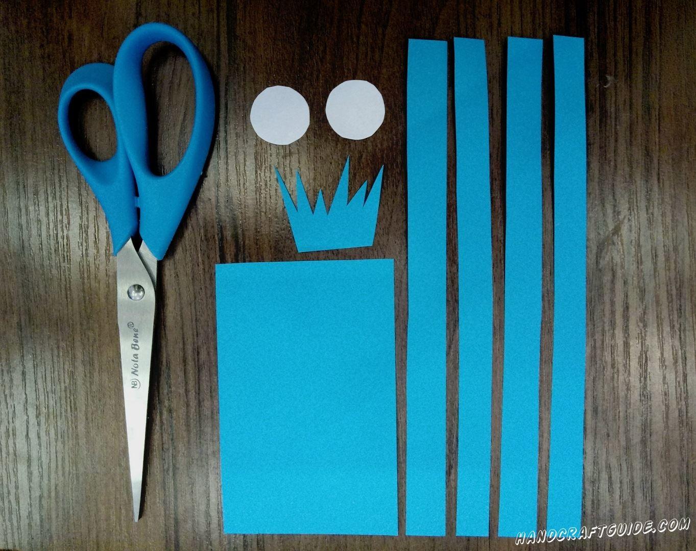Давайте возьмем лист голубой бумаги и ножницы. Вырезаем 1 прямоугольник, 4 длинные полоски и одну детальку, похожую на прическу из японских аниме:) Напоследок вырезаем 2 белых кружка. Подготовка окончена, переходим дальше