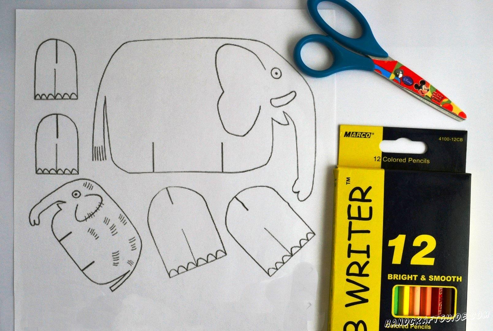На белом листе бумаги мы рисуем тельце большого и маленького слона, а также мы рисуем лапки. В общем, срисуйте картинки, показанные на фото.