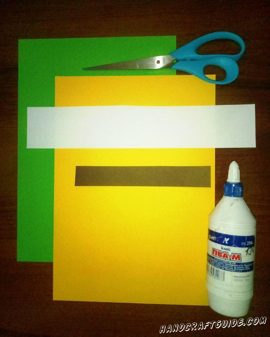 Для выполнения данной поделки нам понадобится: Цветная бумага (или картон) Ножницы Клей Фломастеры