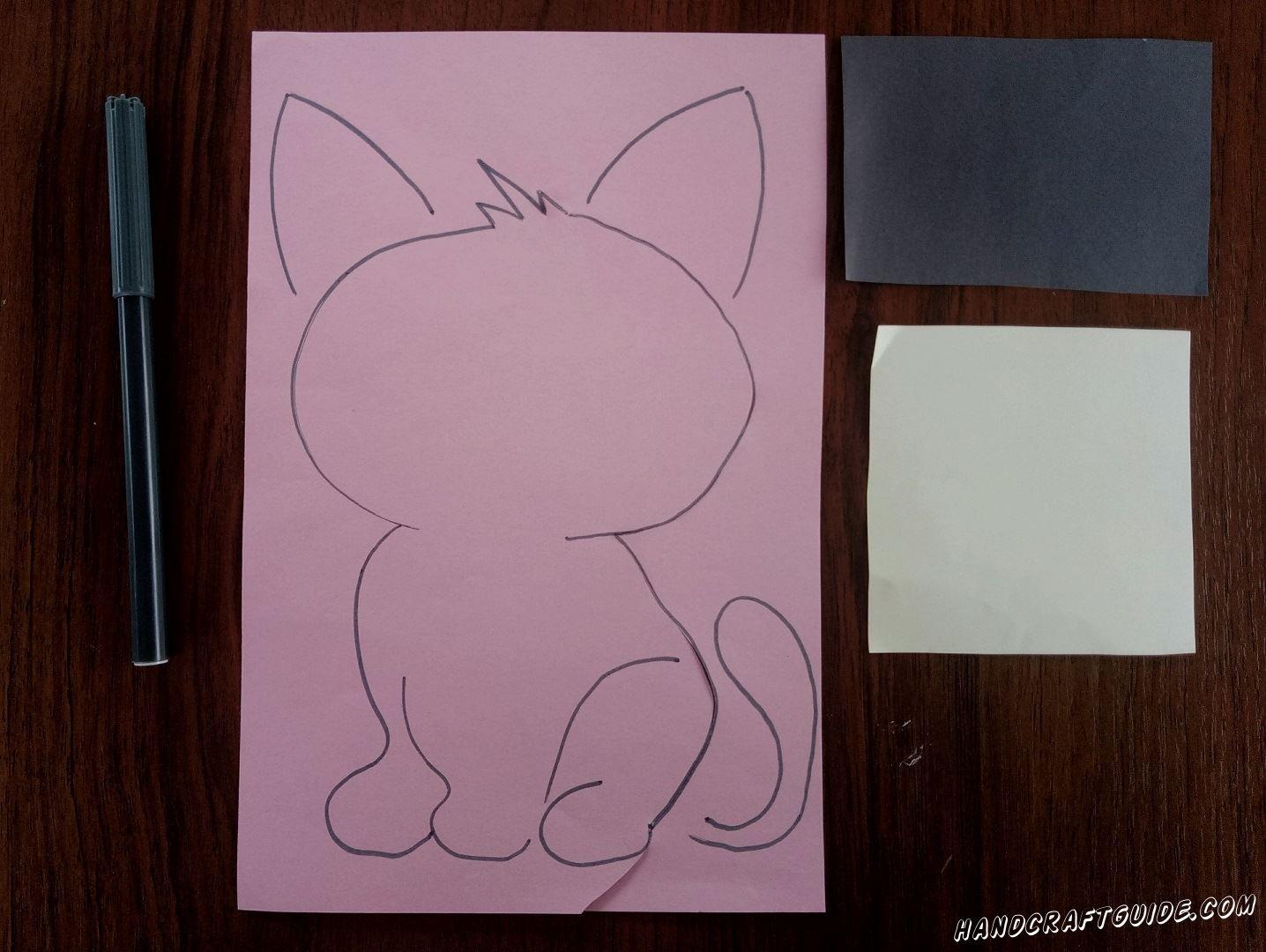Для начала, на розовом листе А4, нарисуем все части нашего будущего котика. Постарайтесь нарисовать как показано на фото
