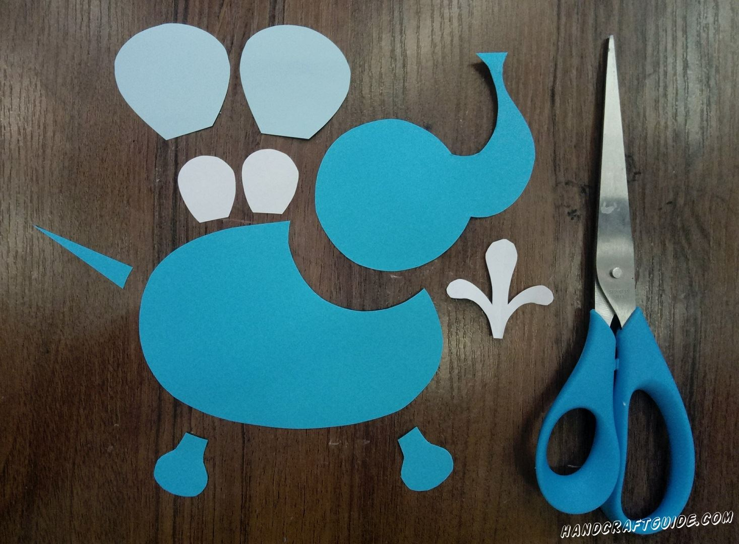 From white, blue, blue paper, we cut out all the details we need, as in the photo.