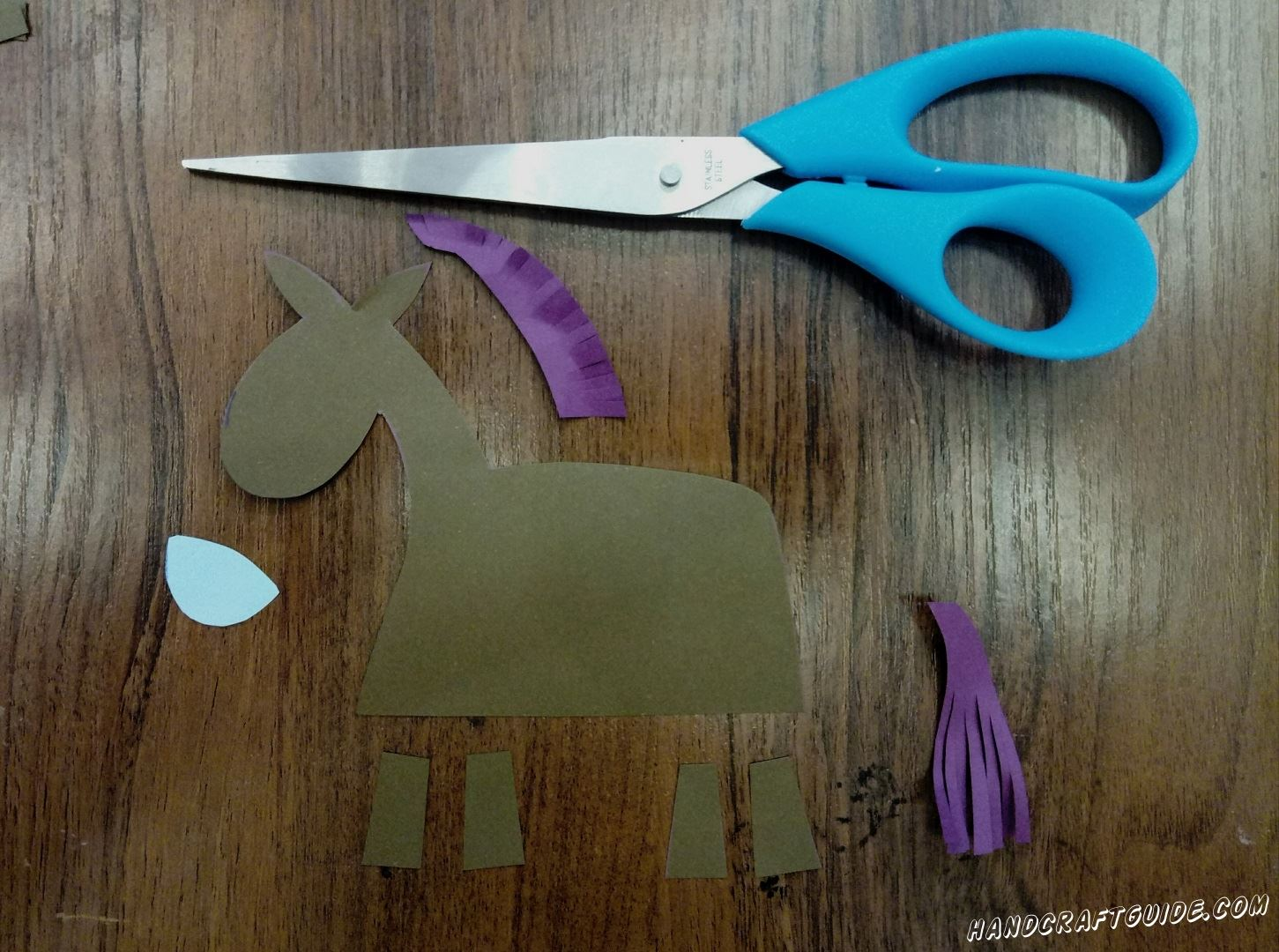 From white, brown and violet paper, we cut out all the details we need, as in the photo.
