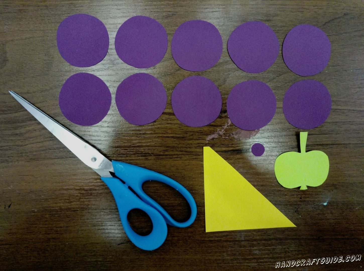 From violet, green and yellow paper, we cut out all the details we need, as in the photo.