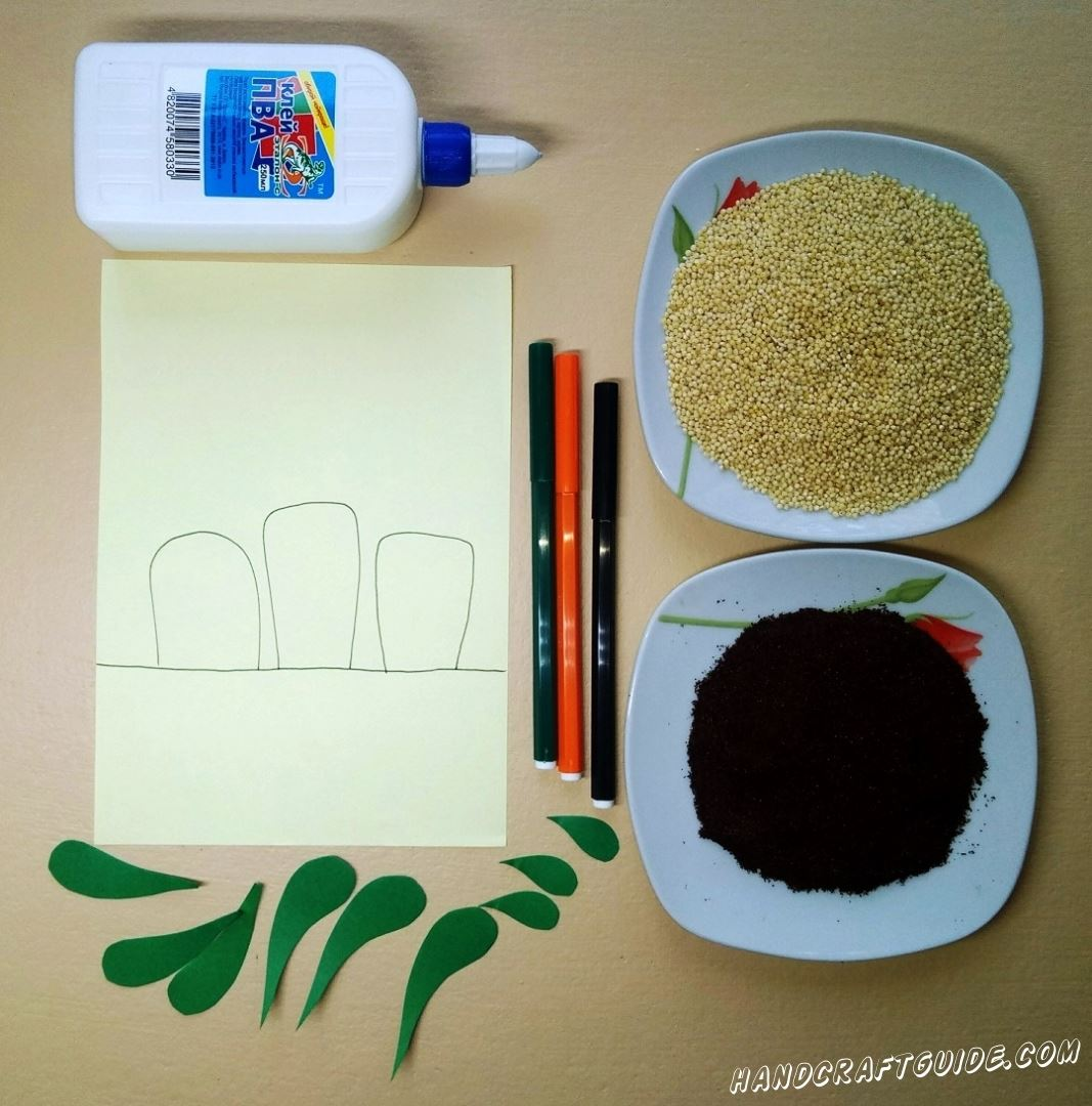 На светло-желтом листе бумаги мы рисуем «горизонт» и три морковки, только наполовину