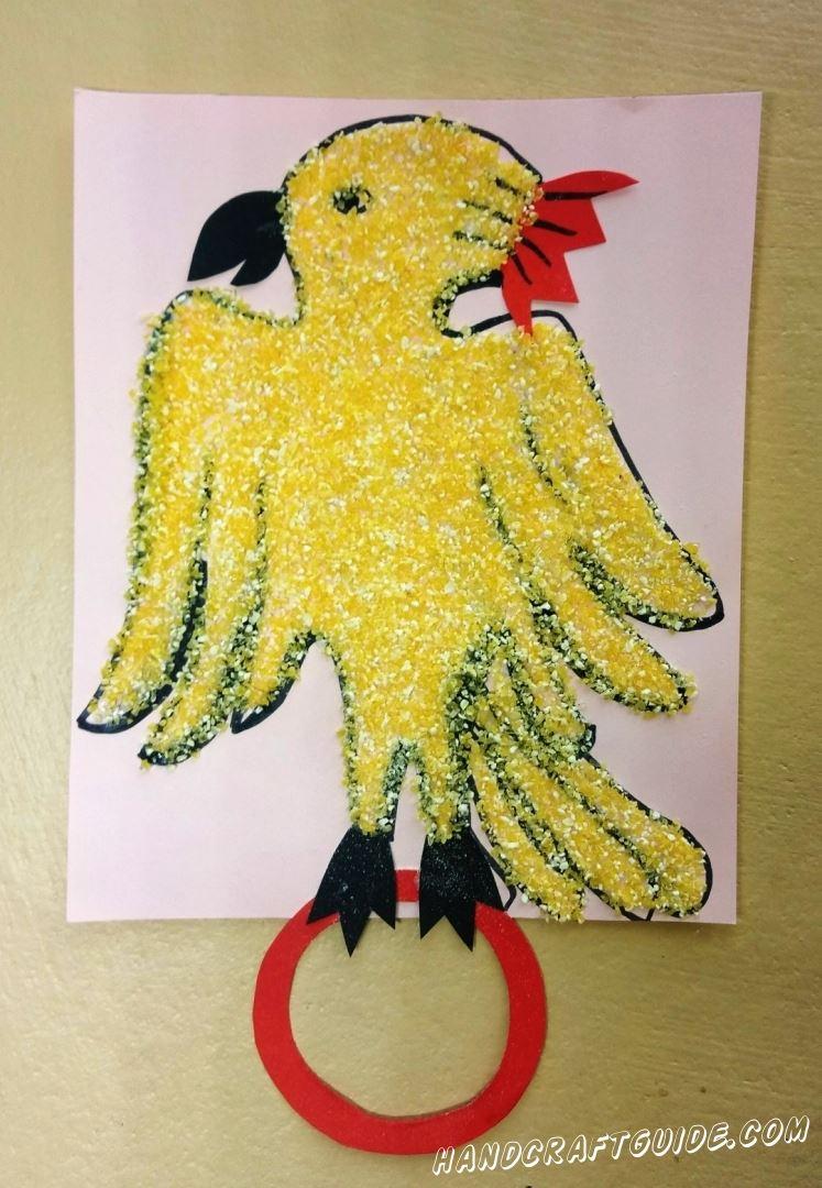 аппликация попугая из кукурузной крупы для детей