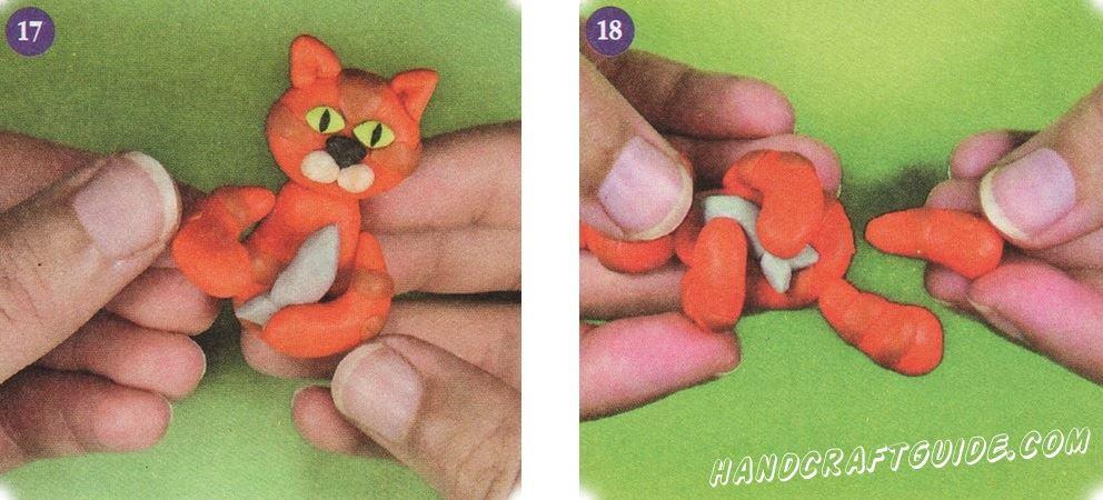 Теперь прикрепите передние лапки к телу, так чтобы кошка обнимала рыбу. Прикрепите задние лапки.