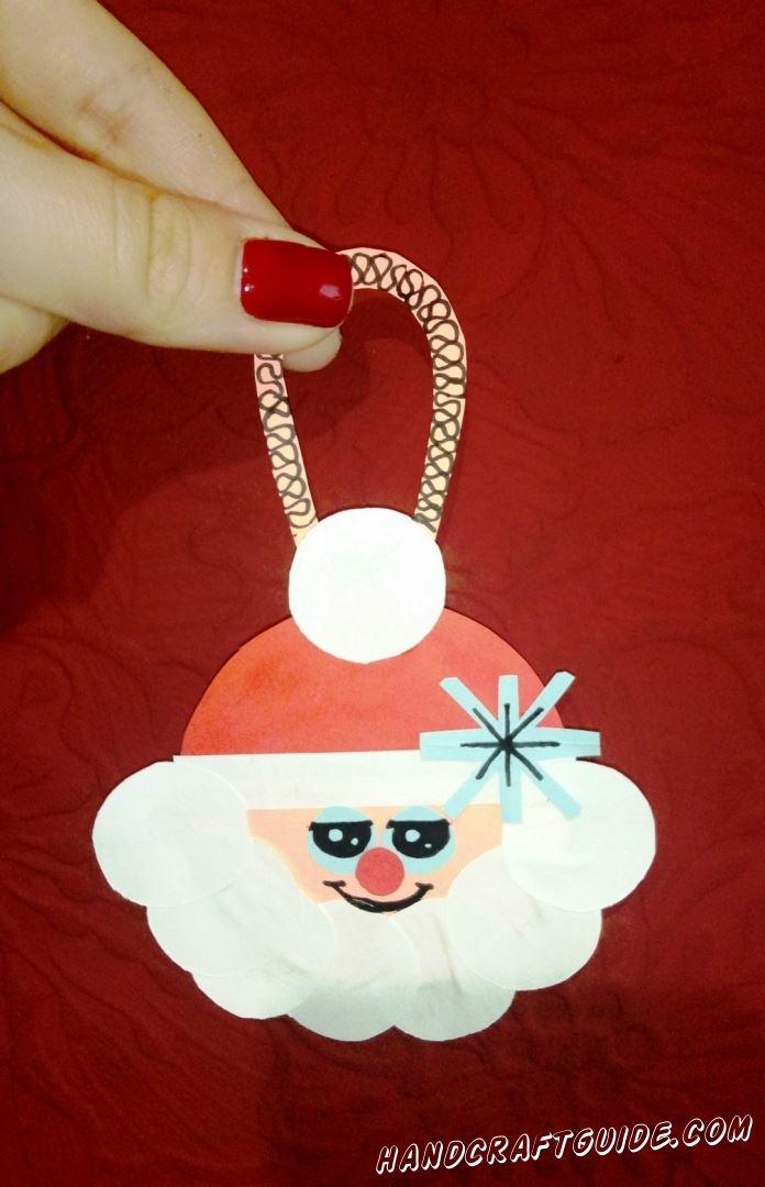 Бумажная игрушка с довольным Дед Морозом, с удовольствие украсит вашу новогоднюю ёлочку.