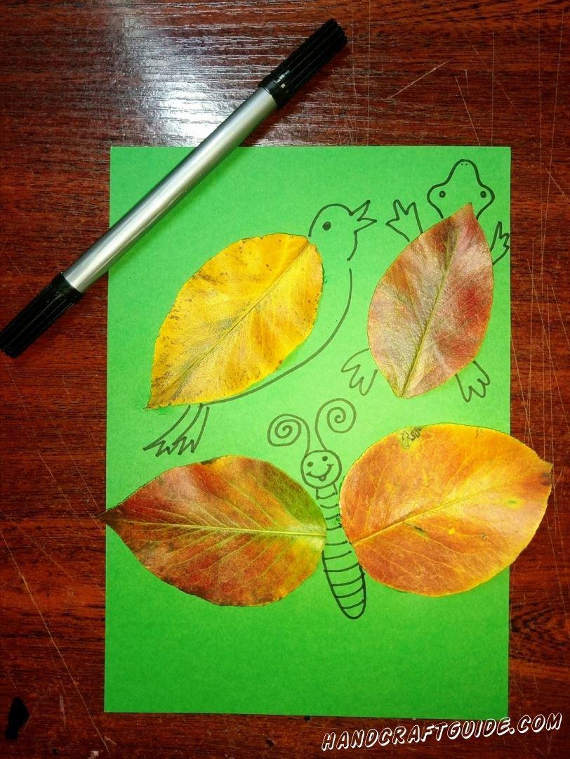 Теперь рисуем вокруг листочков птичку, бабочку и черепашку