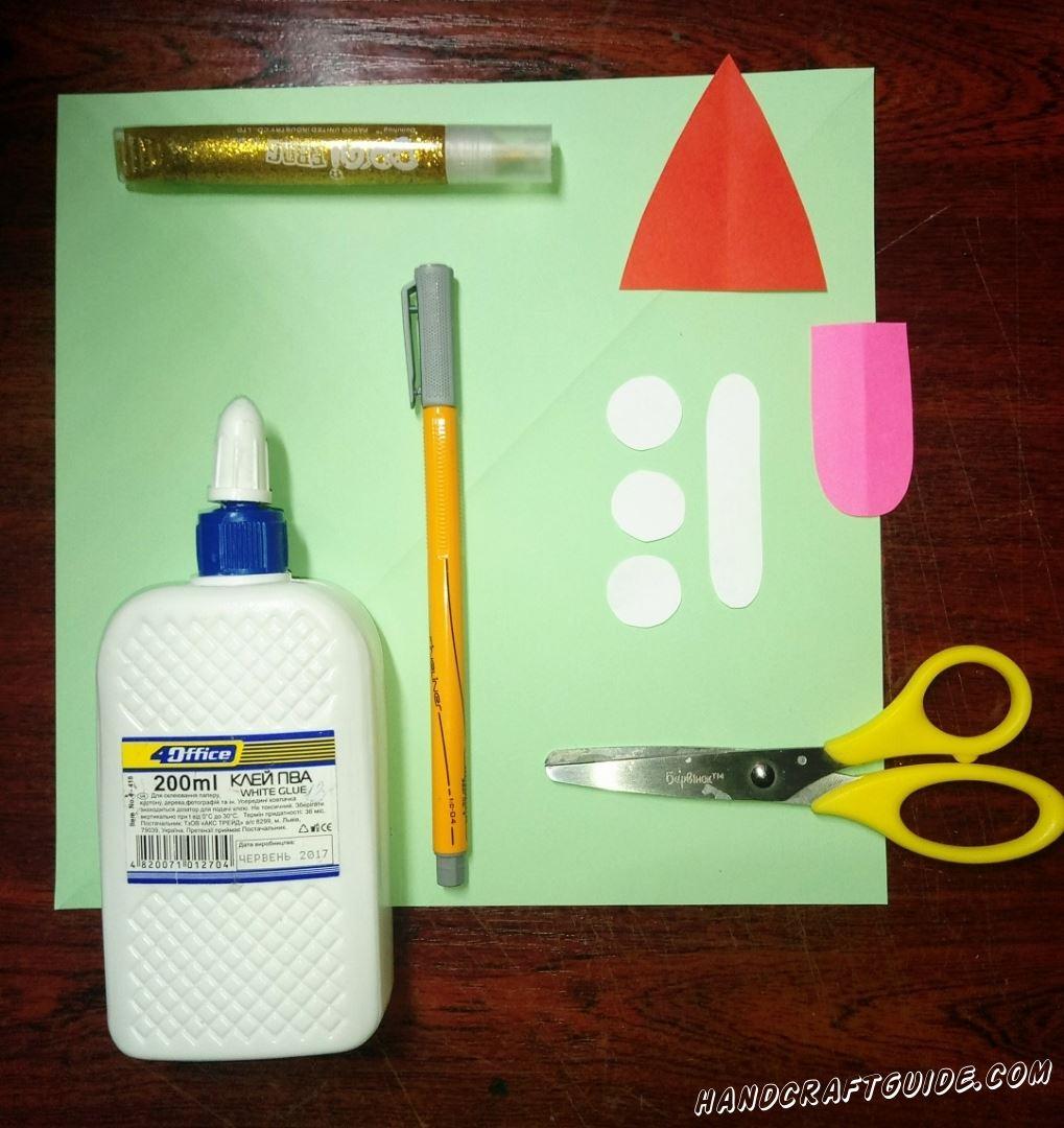 Вырезаем один бумажный треугольник красного цвета, розовый язычок,  три кружочка и полосочку, из бумаги белого цвета.