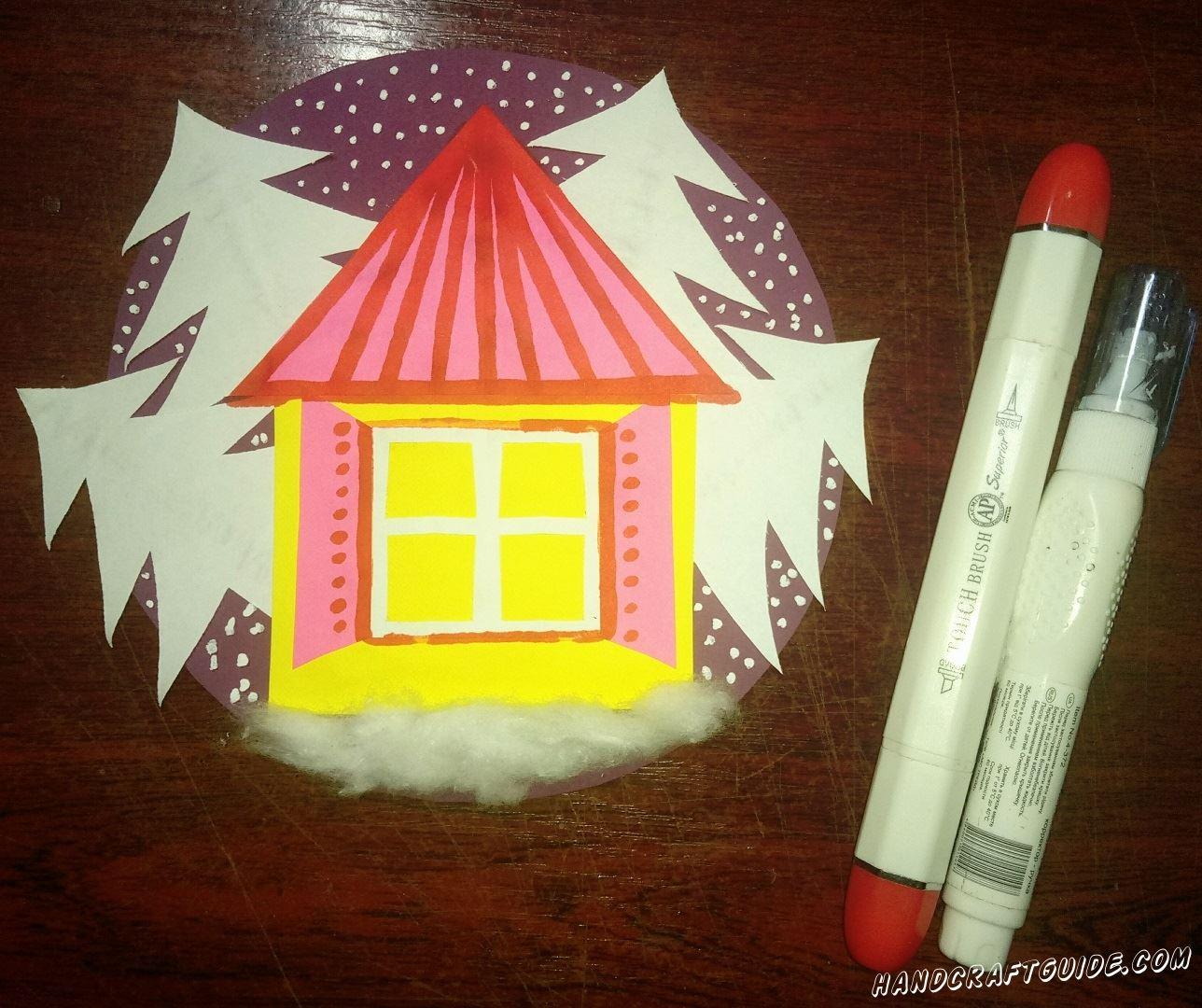 Корректором или белой краской рисуем снежинки, летящие среди деревьев. А также красиво разрисовываем домик, с помощью фломастеров