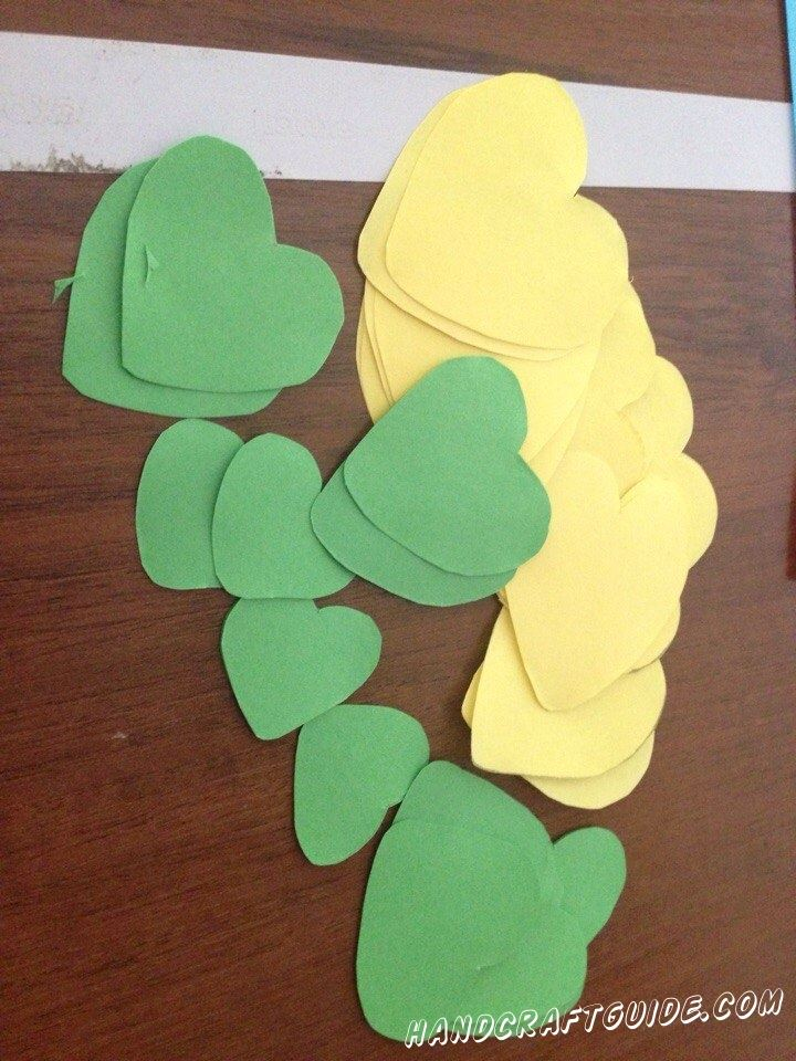 Cut the colored paper (red, yellow, green, orange) hearts